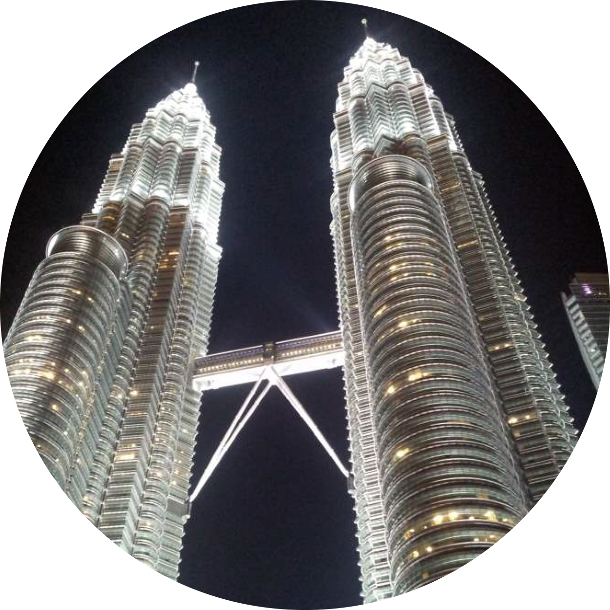 An inmage of the Petronas Twin Towers from the Kuala Lumpur city tour package conducted by the dedicated Malaysian tour guides here at MM Adventure, representing the vibrant, historical cities you can explore when travelling in and around Kuala Lumpur, Malaysia.